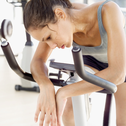 tired woman exercise bike